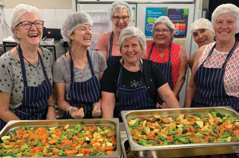 Group of female volunteers in soup kitchen