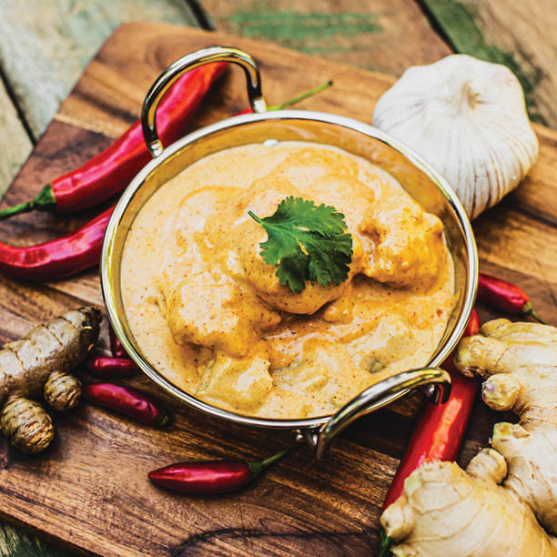 vEEF Butter Chicken with complementary ingredients